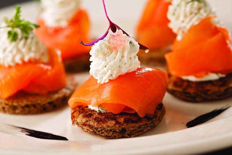 Buckwheat flour blinis with cured salmon, lemon cream and microgreens