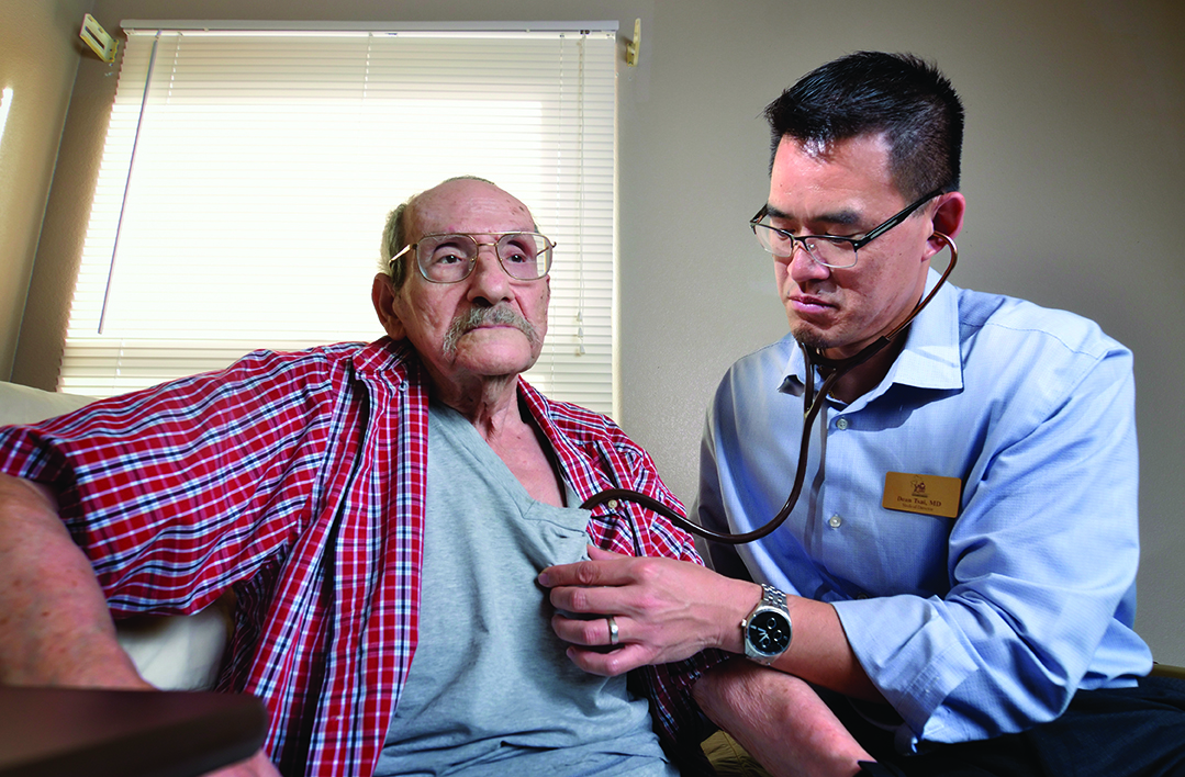 Heart to heart: Dr. Tsai makes a house call on hospice patient Joseph Mercorella.