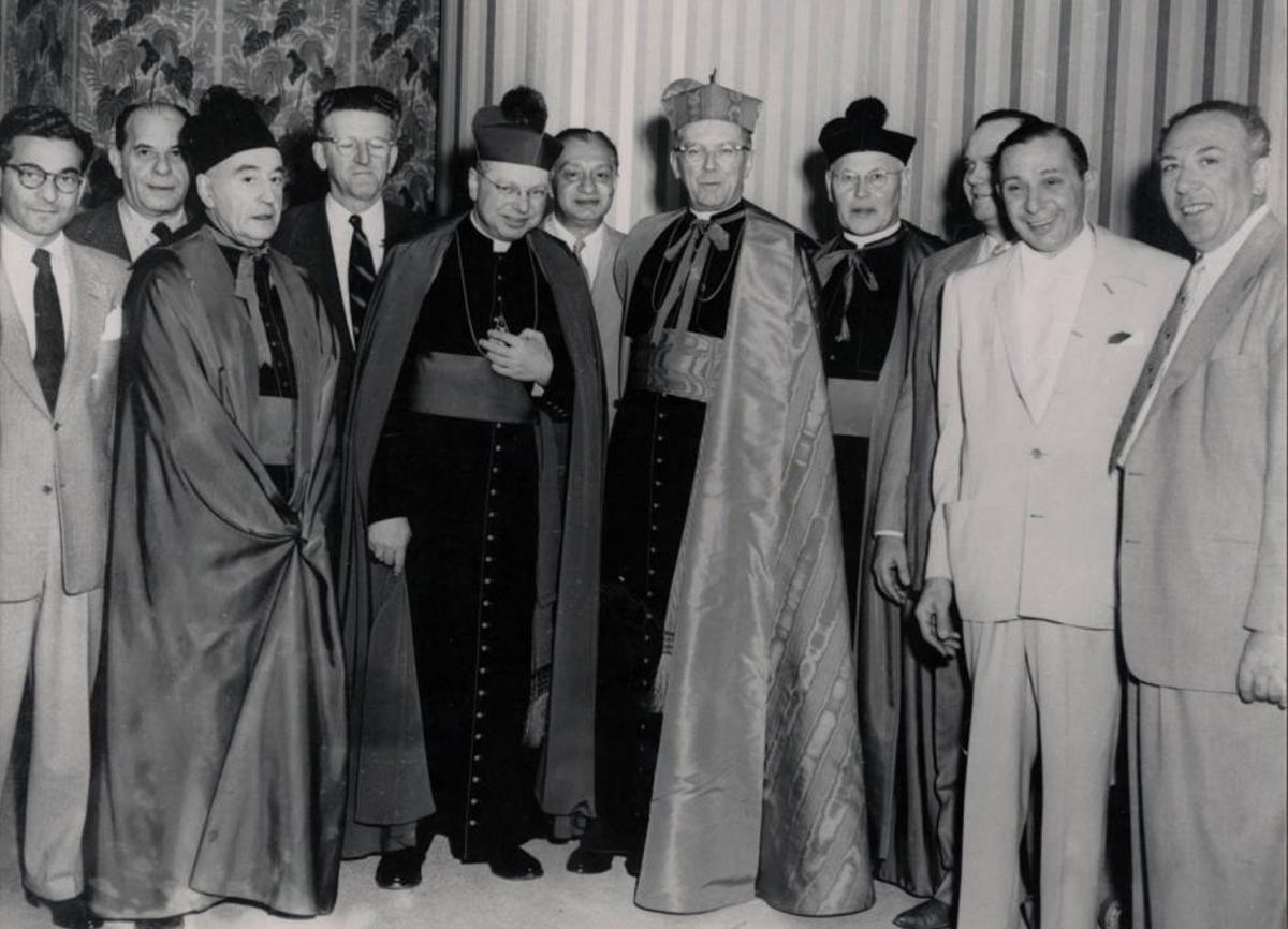 Gus Greenbaum, second from left, appears at an event to donate land for the construction of the Guardian Angel. Greenbaum gave generously to churches and charities.