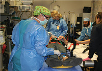 The UMC Trauma team in action. As Dr. Coates often tells them, their decisions have to be both quick and right.