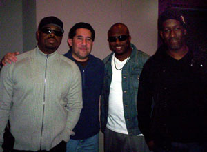 Boyz II Men with host Luis Hernandez