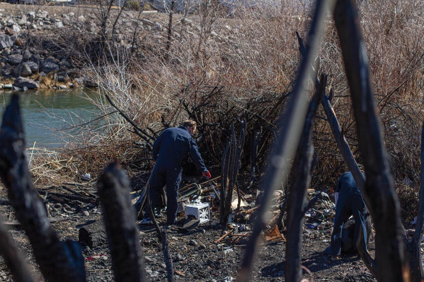RESTORE AND PROTECT: Brian Wohlgemuth and other River Justice activists collect trash along the Truckee River.