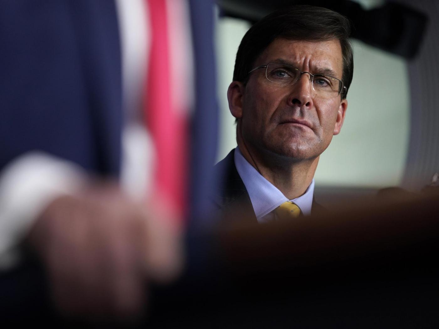 Defense Secretary Mark Esper listens as President Trump speaks during a news briefing with the Coronavirus Task Force at the White House on last week.