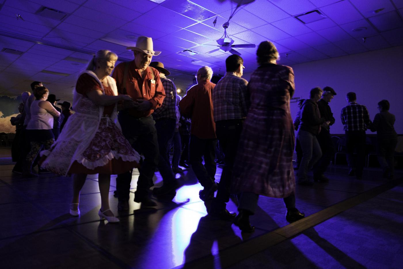 Cowboy Poetry Gathering attendees get a move on at a lively square dance.