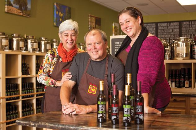 Live and let olive: Mercedes, John and Julie Burkavage, and some of the colorful olive oils and vinegars they sell in their Summerlin store.