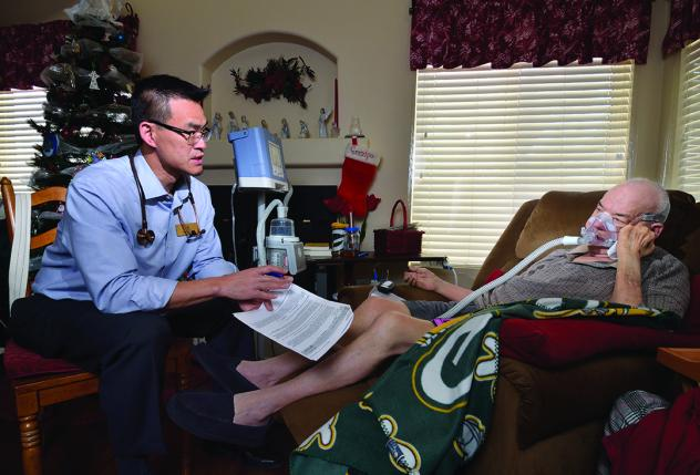 By your side: Dr. Dean Tsai visits with Gary Gould, a hospice patient suffering from ALS.