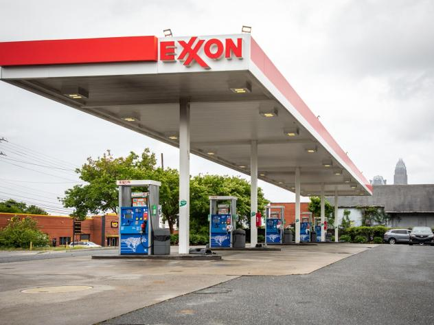 Pictured are pumps at an Exxon gas station in Charlotte, N.C. A tiny fund got two board members elected to the oil giant's board, delivering a historic defeat to ExxonMobil.