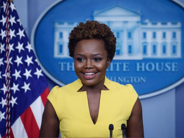 """White House principal deputy press secretary Karine Jean-Pierre arrives for the press briefing Wednesday. """"I believe being behind this podium, being in this room, being in this building, is not about one person,"""" she said of the historic nature of her tu"""