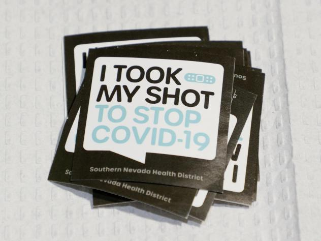 Stickers are stacked up for people receiving vaccinations at a pop-up COVID-19 vaccination clinic in Las Vegas on May 21. As countries open their doors to travelers again, there is confusion about how people will prove their vaccination status.