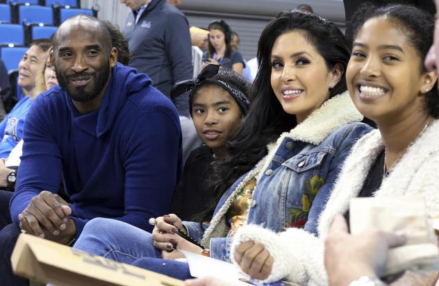 Basketball great Kobe Bryant (from left), daughter Gianna, wife Vanessa and daughter Natalia are seen before an NCAA college women's basketball game in 2017 in Los Angeles. Vanessa Bryant says Nike is making, without her consent, a shoe she designed in h