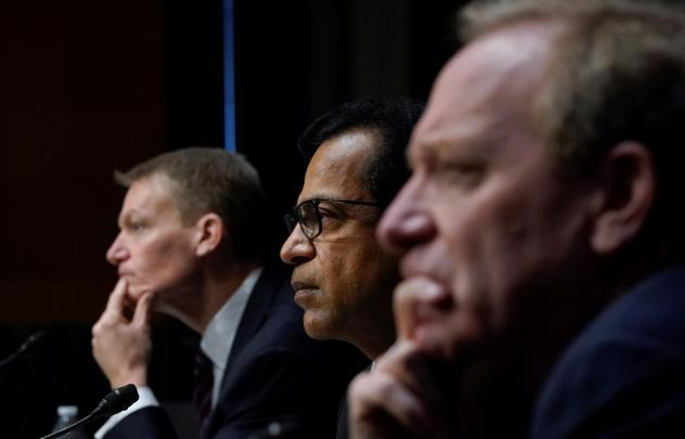 FireEye CEO Kevin Mandia, SolarWinds CEO Sudhakar Ramakrishna and Microsoft President Brad Smith testify during a Senate Intelligence Committee hearing on Capitol Hill on Feb. 23, in Washington, D.C. The hearing focused on the 2020 cyberattack that resul