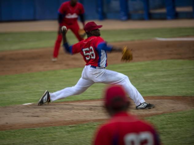 Cuba's pitcher Yoanni Yera Montalvo throws the ball during a training session at the Estadio Latinoamericano in Havana last month. Cuba's losses this week in Florida to Venezuela and Canada in Olympic baseball qualifying play means the team will not comp