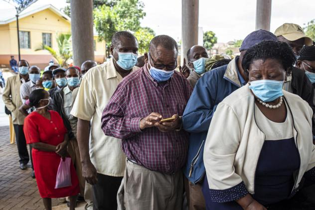 Vaccine doses are in short supply in African countries — and even when they arrive, there may not be a way to get them into people's arms in a timely fashion. Above: People wait to get vaccinated at a hospital in Thika, Kenya, in March.