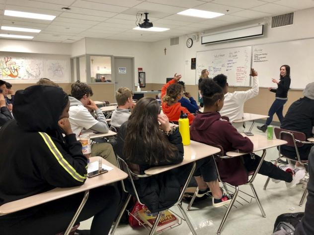 Instructors lead a classroom discussion about consent and healthy relationships with a class of sophomores at Central Catholic High School in Portland, Ore., in 2019. (Gillian Flaccus/AP)