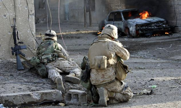 U.S. Marines take cover as they push into the center of Fallujah, Iraq, in November 2004. The battle for the city produced the heaviest urban fighting of the Iraq war.