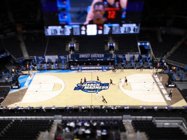 The March Madness logo on the court during the Sweet Sixteen round of the 2021 NCAA Men's Basketball Tournament in Indianapolis. Soon, some college athletes can get money when using their name, image or likeness.