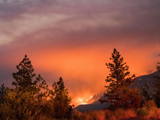 Wildfire burns above the Fraser River Valley near Lytton, British Columbia, Canada, on Friday.