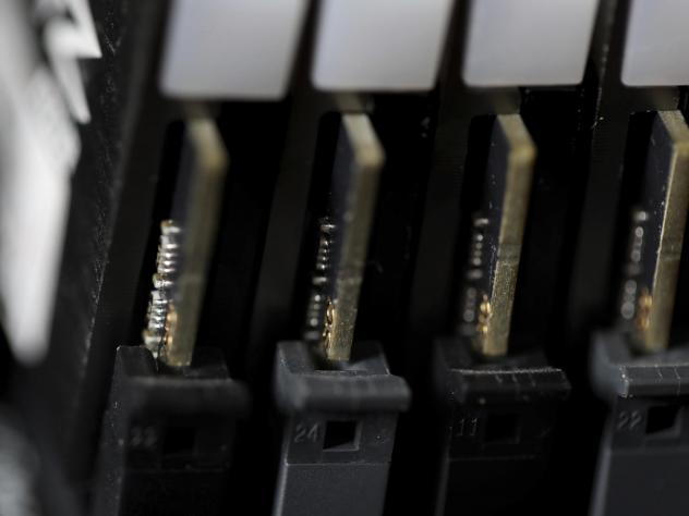 This file photo shows the inside of a computer in Jersey City, N.J. Cybersecurity teams worked feverishly Sunday, July 4, to stem the impact of the single biggest global ransomware attack on record, with some details emerging about how the Russia-linked