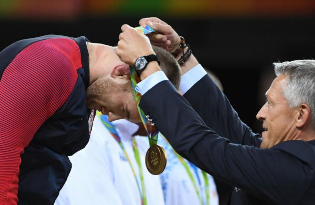 American gold medalist Kyle Frederick Snyder receives his medal at the end of the men's 97-kilogram freestyle wrestling event during the 2016 Olympic Games in Rio de Janeiro.