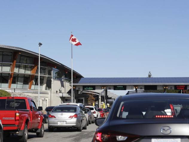 Traffic enters Canada from the United States at the Peace Arch Border Crossing in Blaine, Wash., in 2019. Vaccinated Americans will be able to travel to Canada, starting Aug. 9.