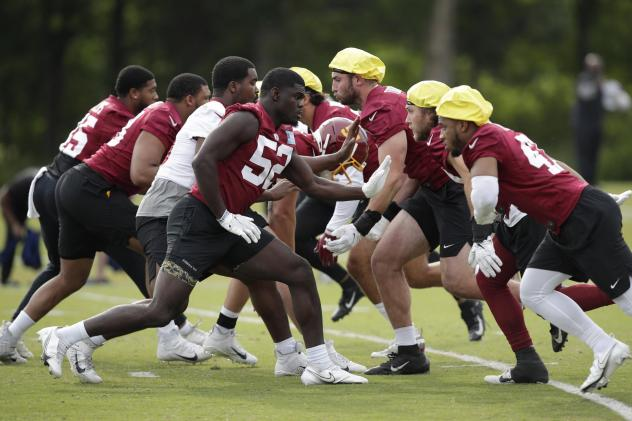 The Washington Football Team during a June practice. The team was one of the last in the league to reach a 50% vaccination threshold among its players.