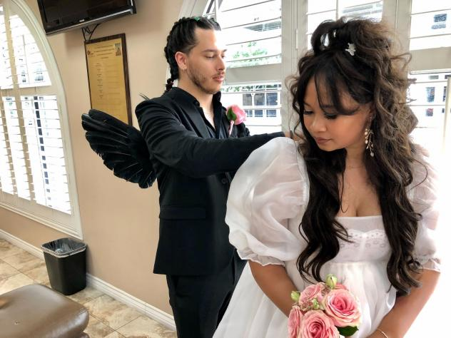Shannon Santos and Greg Daly prepare for themed wedding photos at a chapel in Las Vegas on July 21, 2021.
