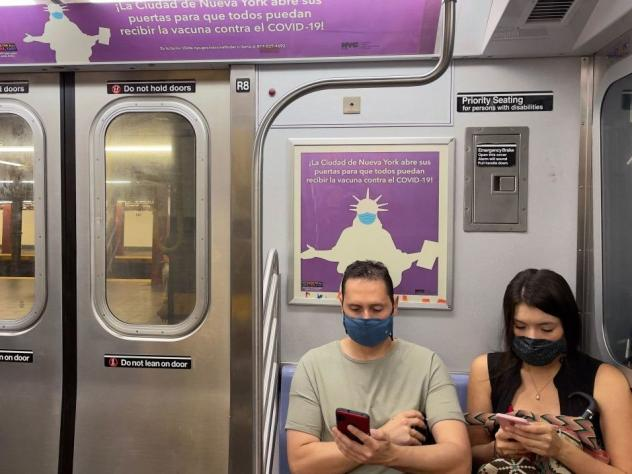 Subway riders mask up this month in New York City. Wearing masks in all kinds of indoor settings may be the safest way to slow the spread of the delta variant, many health experts say.