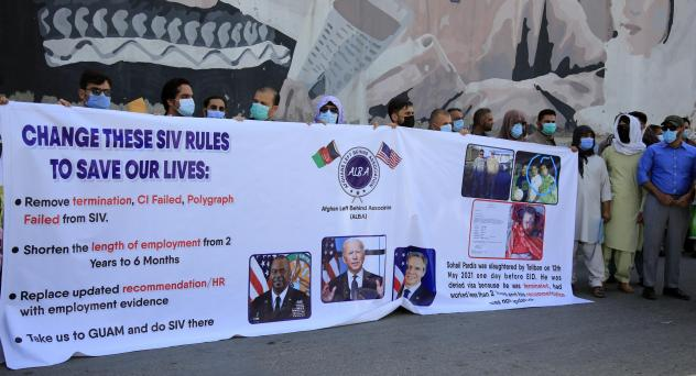 Former Afghan interpreters demonstrate in June outside the U.S. Embassy in Kabul. They called for the Biden administration to modify the rules and speed up the processing of U.S. visas that have been promised to Afghans who worked for the U.S. military o