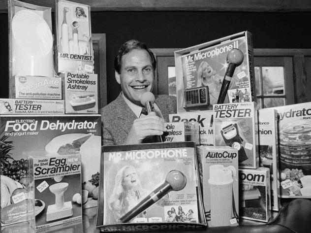 In this 1982 file photo, Ron Popeil, the man behind those late-night, rapid-fire television commercials that sell everything from the Mr. Microphone to the Pocket Fisherman to the classic Veg-a-Matic, sits surrounded by his wares in his office in Beverly