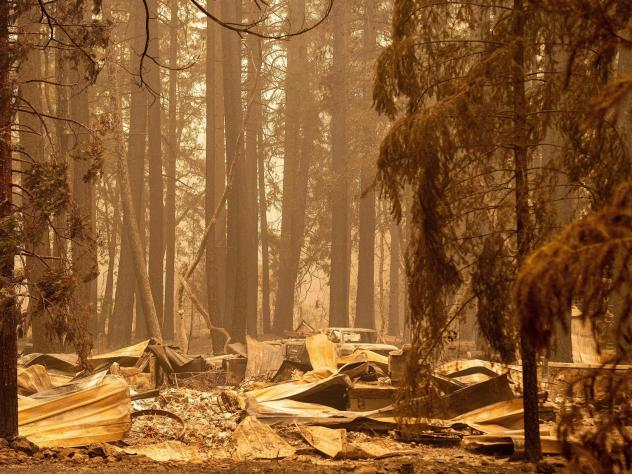 The remains of a burned home are seen in the Indian Falls neighborhood of unincorporated Plumas County, California on July 26, 2021. Extreme weather events have claimed hundreds of lives worldwide in recent weeks, and upcoming forecasts for wildfire and