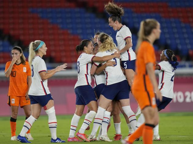U.S. players celebrate a goal scored by teammate Lynn Williams during a women's quarterfinal soccer match against The Netherlands on Friday at the Summer Olympics in Yokohama, Japan.