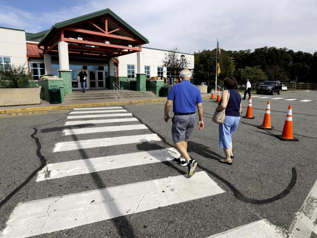 People head into the service building at the Cheesequake Rest Area in South Amboy, N.J.