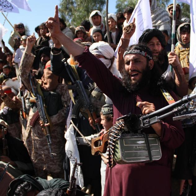 Afghan Taliban fighters and villagers attend a gathering in Laghman province, Alingar district, in March 2020 as they celebrate the peace deal signed between the U.S. and the Taliban.