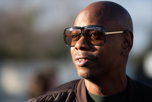 <em>Dave Chappelle: This Time This Place</em> chronicles Chappelle's efforts to entertain audiences during the pandemic with a series of outdoor shows. He's pictured above in North Charleston, S.C., on Jan. 30, 2020.