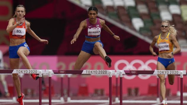 Sydney Mclaughlin, of the United States, wins the women's 400 meter hurdles final at the Summer Olympics in Tokyo.
