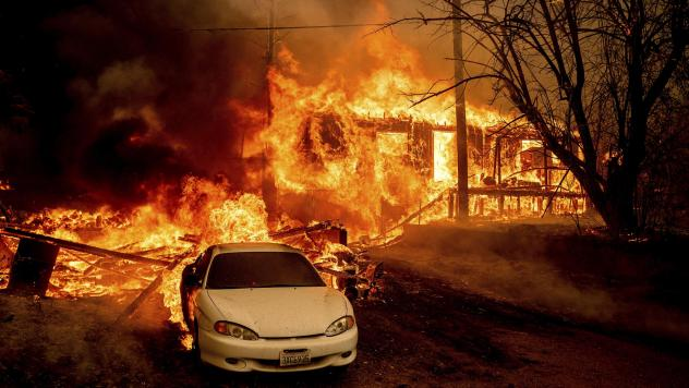 Flames from the Dixie Fire consume a home on Highway 89 south of Greenville, Calif., on Thursday.