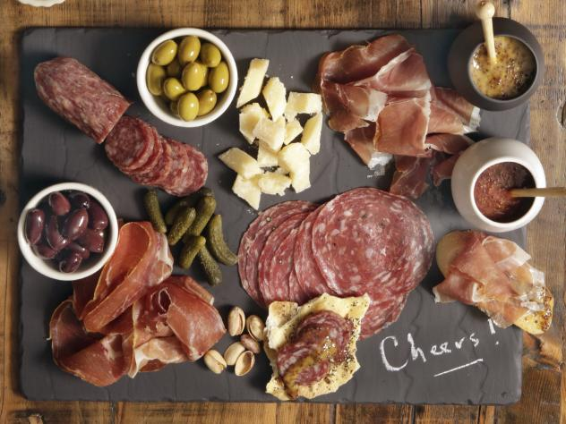 The Centers for Disease Control and Prevention is investigating two salmonella outbreaks that are tied to Italian-style meats like salami and prosciutto that are often used for charcuterie boards.
