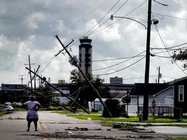 A woman surveys damage Monday from Hurricane Ida in a neighborhood in Kenner, La. The storm was fueled by abnormally warm water in the Gulf of Mexico.