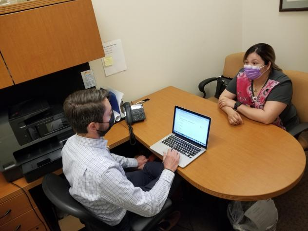 Attorney Marc Scanlon meets with client Kimberly Ledezma at Salud Family Health Centers' clinic in Commerce City, Colo. Every day in this Denver suburb, four lawyers join the clinic's physicians, psychiatrists and social workers to consult on cases, as p