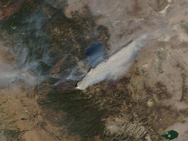 This Sunday, Aug. 29, 2021, image provided by Maxar Technologies, shows a Moderate Resolution Imaging Spectroradiometer (MODIS), a true-color image overview of the wildfires at Lake Tahoe, in South Lake Tahoe, Calif. Climate change has made the region wa