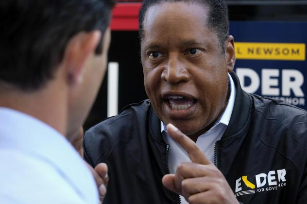 Republican conservative radio show host Larry Elder argues with a TV reporter in an interview Monday after visiting Philippe the Original deli during the campaign for the California gubernatorial recall election in Los Angeles.
