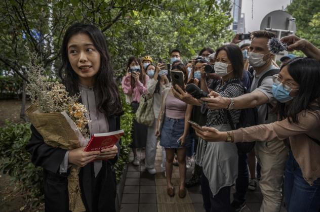 Zhou Xiaoxuan speaks to journalists and supporters on Sept. 14 outside the Haidian District People's Court in Beijing before a hearing in her case. She alleged that she was groped and forcibly kissed by prominent TV anchor Zhu Jun, who denies the allegat