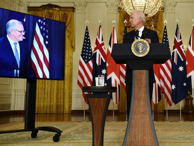 President Biden speaks to Australian Prime Minister Scott Morrison on Wednesday during the virtual announcement of a trilateral defense partnership with Australia and the U.K. British Prime Minister Boris Johnson also joined in.