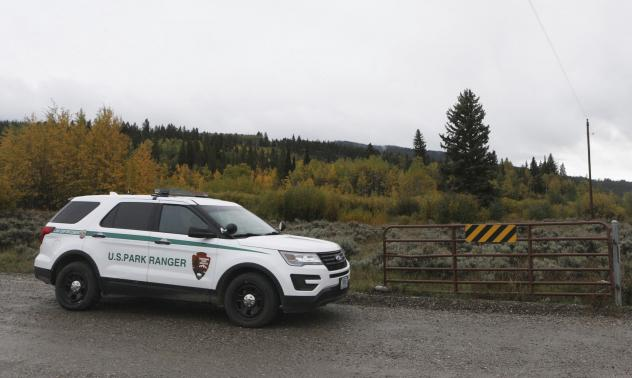 """A U.S. Park Ranger vehicle drives in the Spread Creek area in the Bridger-Teton National Forest, just east of Grand Teton National Park off U.S. Highway 89, on Sunday, in Wyoming. Authorities say they have found a body believed to be Gabrielle """"Gabby"""" Pe"""