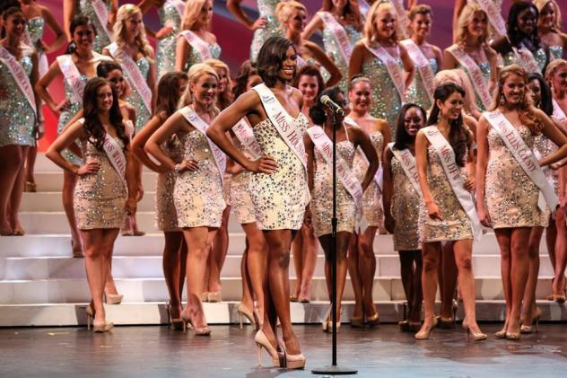 Teacher and coach Isis Smalls with her Miss Houston 2014 crown.