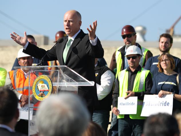 Gov. Jerry Brown speaks to the crowd during the California High-Speed Rail Authority groundbreaking event in Fresno. The $68 billion project faces challenges from Republicans in Congress, and from Central Valley farmers suing to block the train from cros