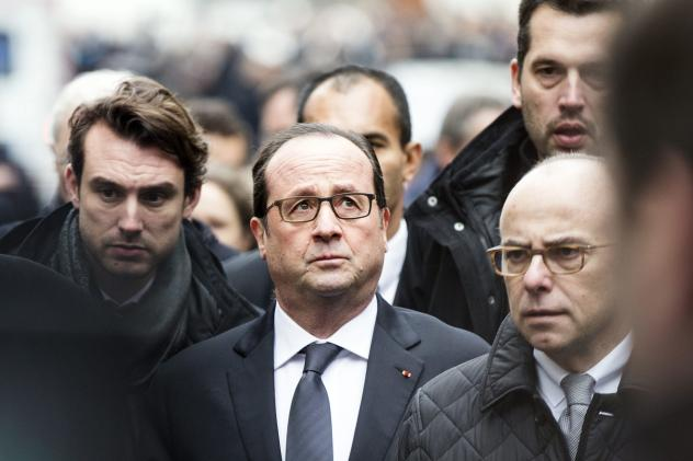 Police forces gather in street outside the offices of the French satirical weekly <em>Charlie Hebdo</em> in Paris on Wednesday, after armed gunmen stormed the offices.
