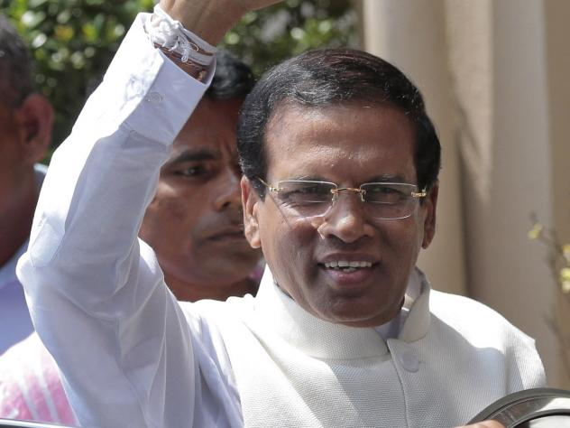Sri Lanka's incoming President Maithripala Sirisena waves to supporters as he leaves the election secretariat in Colombo, Sri Lanka on Friday. Sirisena defeated long-time President Mahinda Rajapaksa.