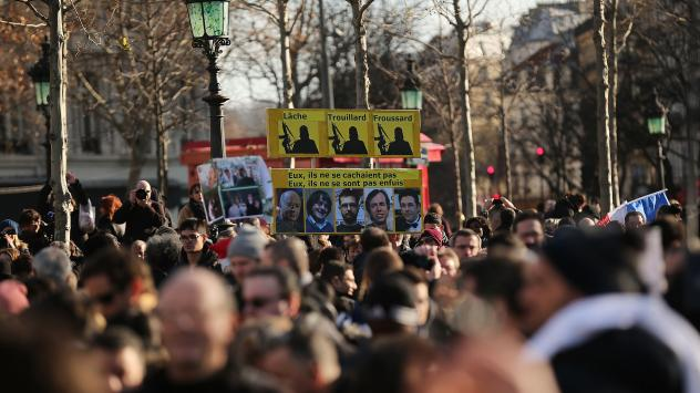 People gather at Place de la Republique before the demonstration in Paris to support victims of last week's violent attacks and free speech.