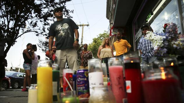 People attend a vigil for Eric Garner near where he died after he was taken into police custody in Staten Island.